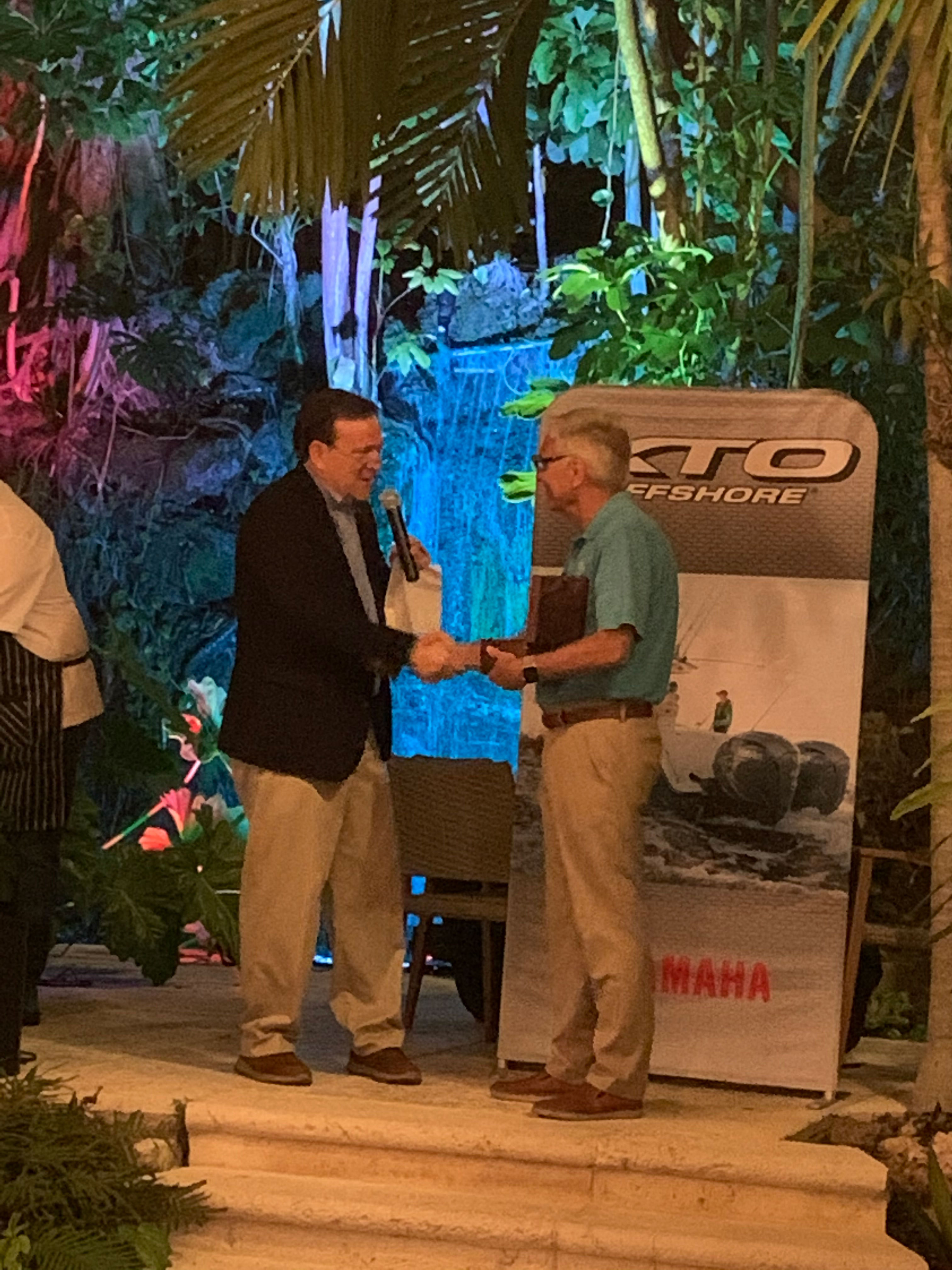 Duane Kuck Accepts Award