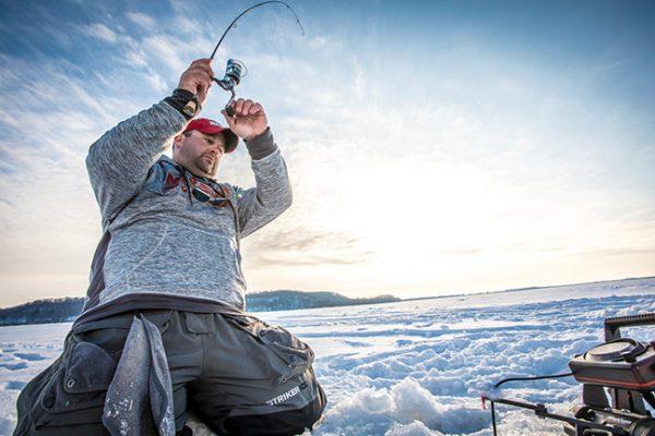 Ice fishing angler