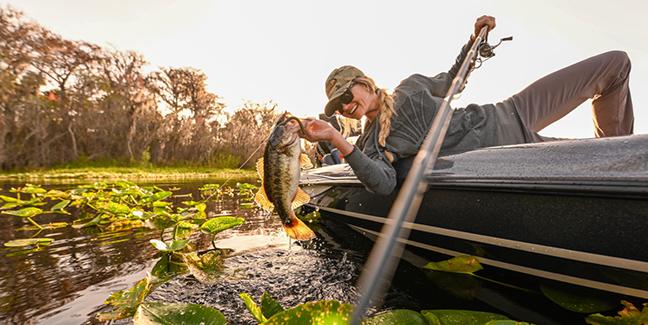 Female Angler Lands Bass