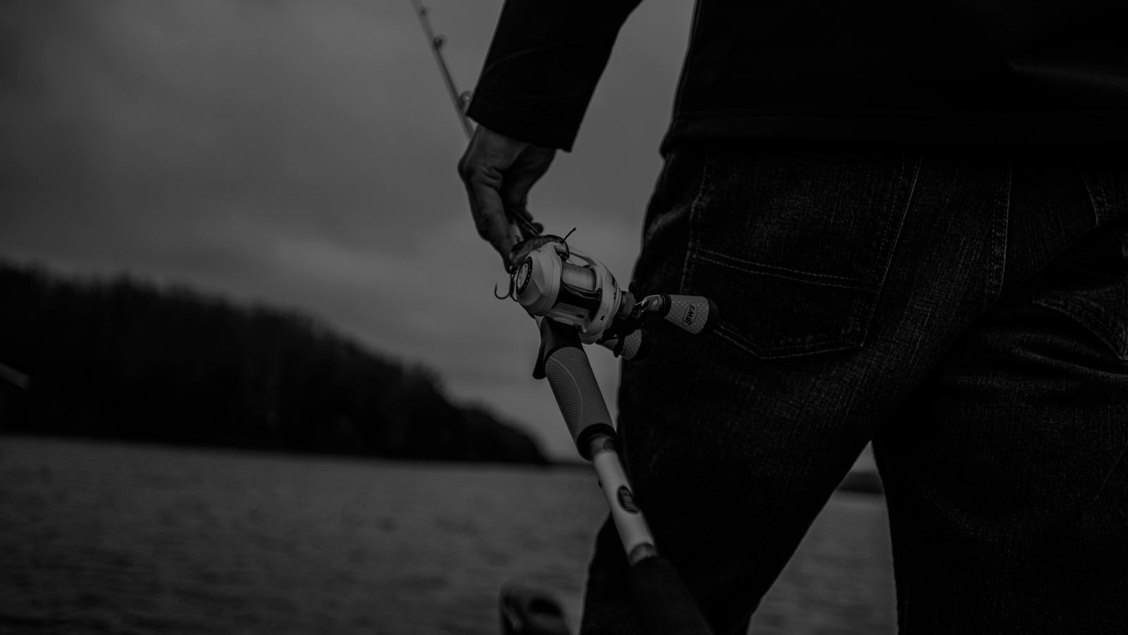Lews Fishing Rod and Reel in Angler's Hand