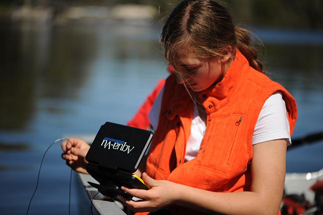 Girl using Aqua-Vu Fishing Camera