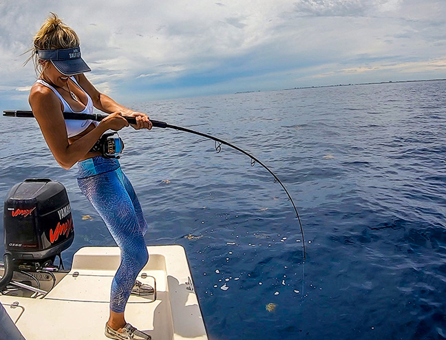 Female Angler Fights Fish