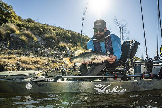 Angler landing Bass in Hobie Kayak