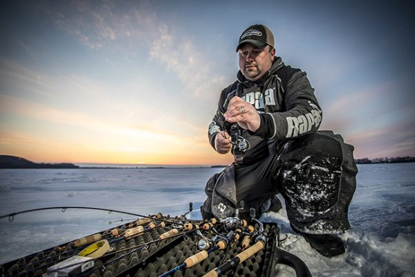 Ice Fishing Angler Gearing Up his Rods