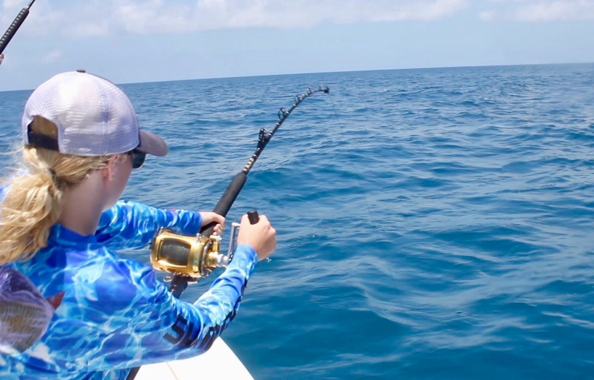 Fighing a grouper on rod and reel