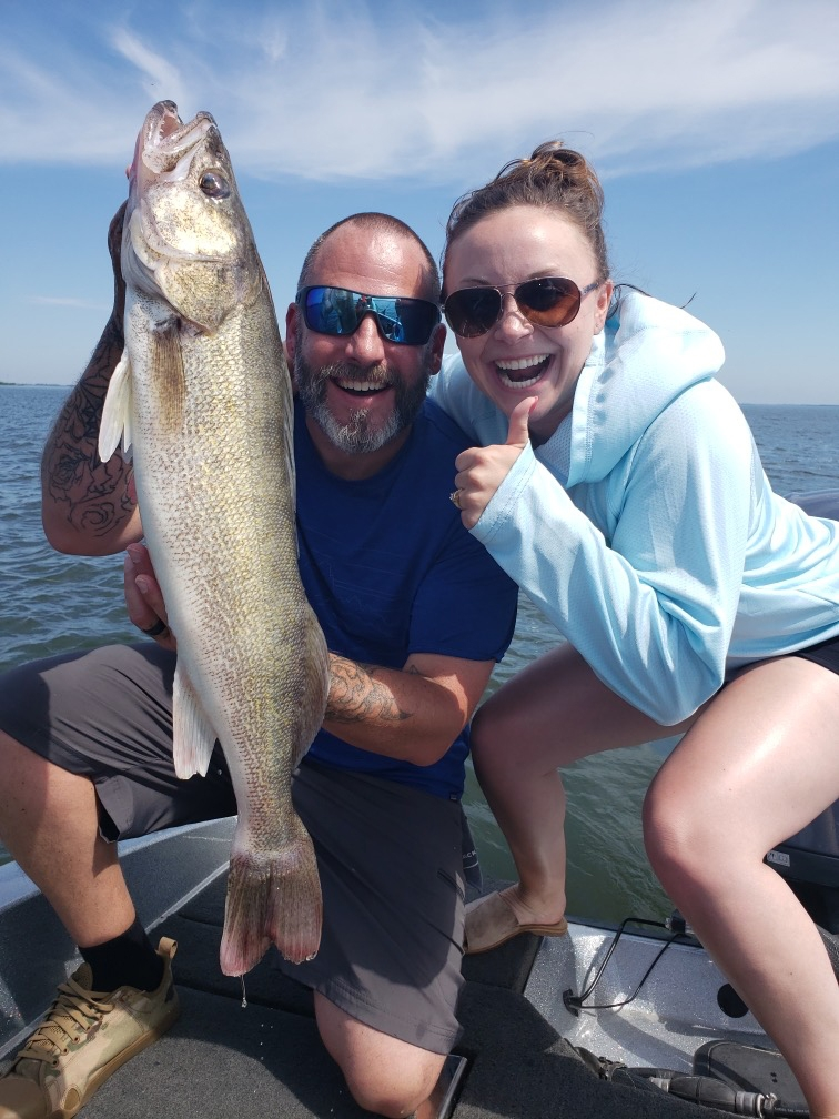Two Anglers Hold Large Walleye