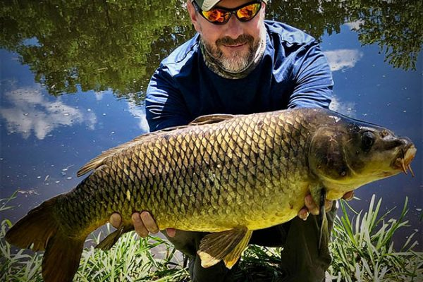 Angler holding Carp