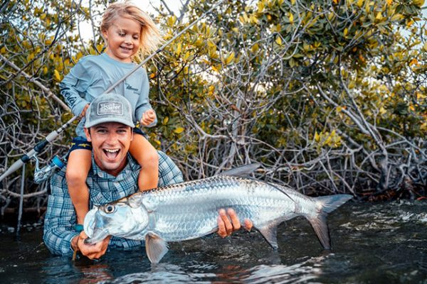 Angler and Daughter with Tarpon