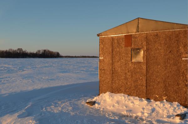 Ice Fishing Shanty on Lake