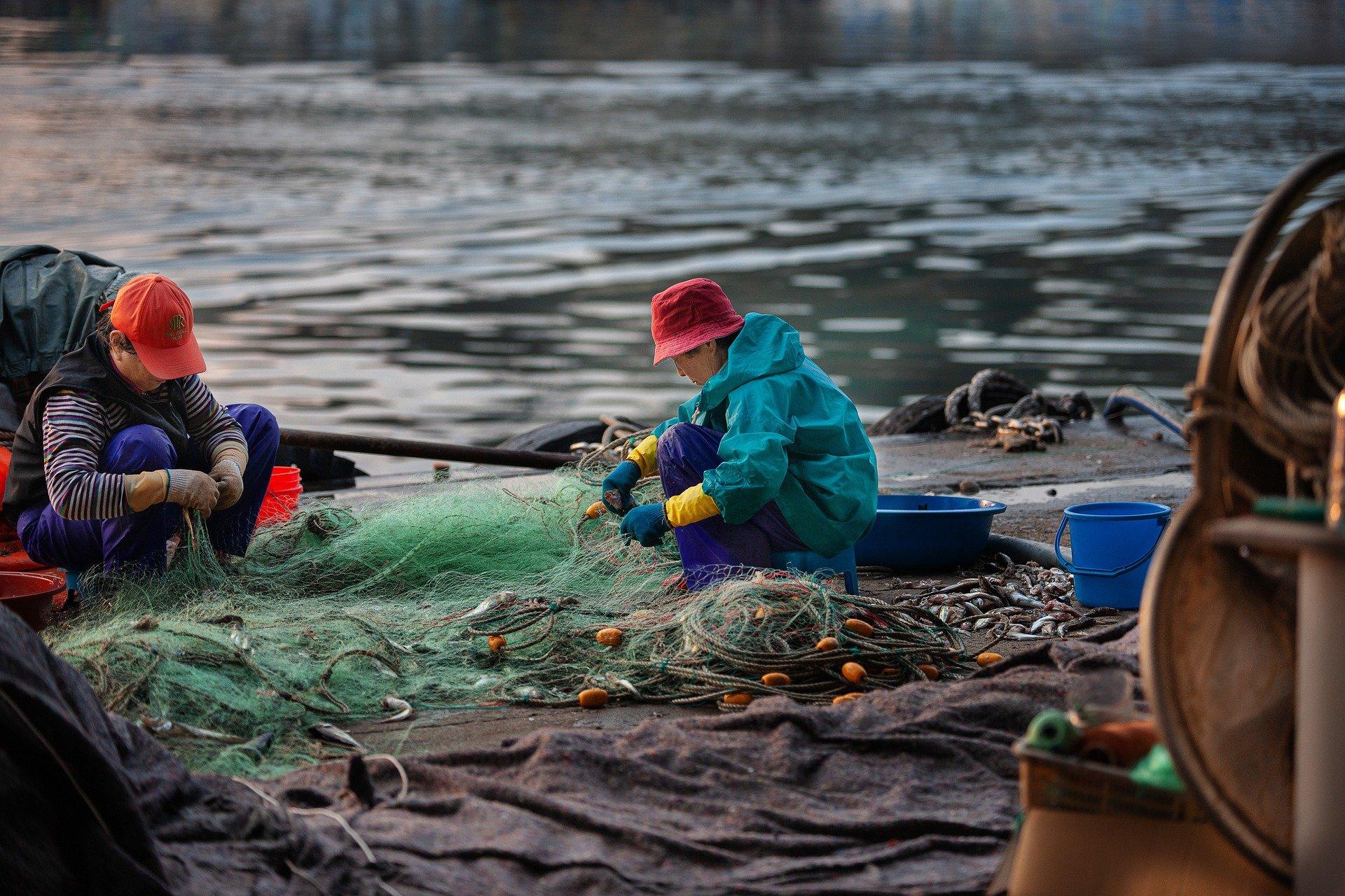 Anglers Mending Fishing Net