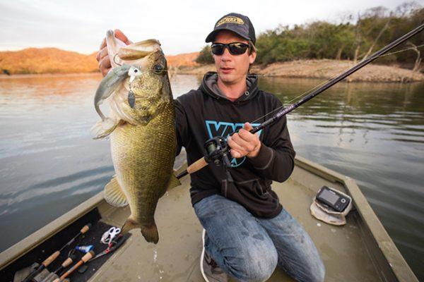 Angler holds bass