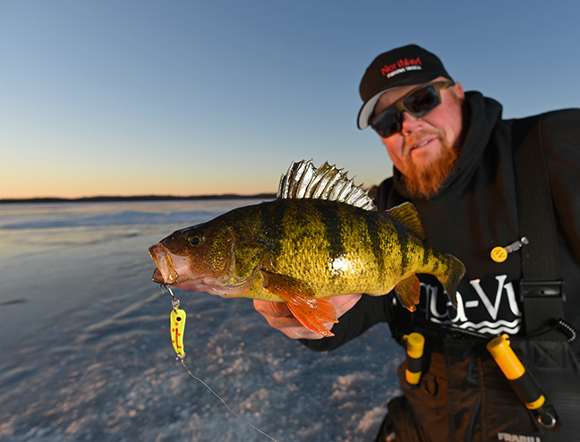Ice Fisherman Holds Perch