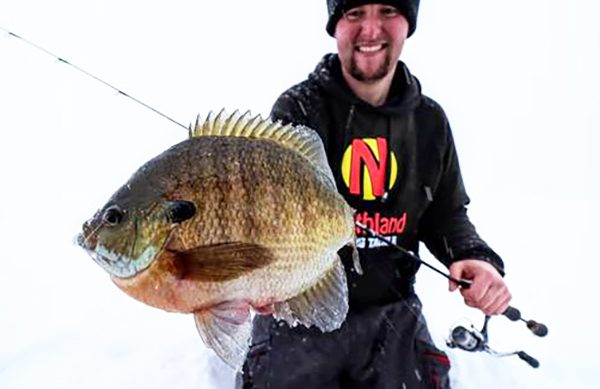 Ice Fishing Angler Holds Bluegill