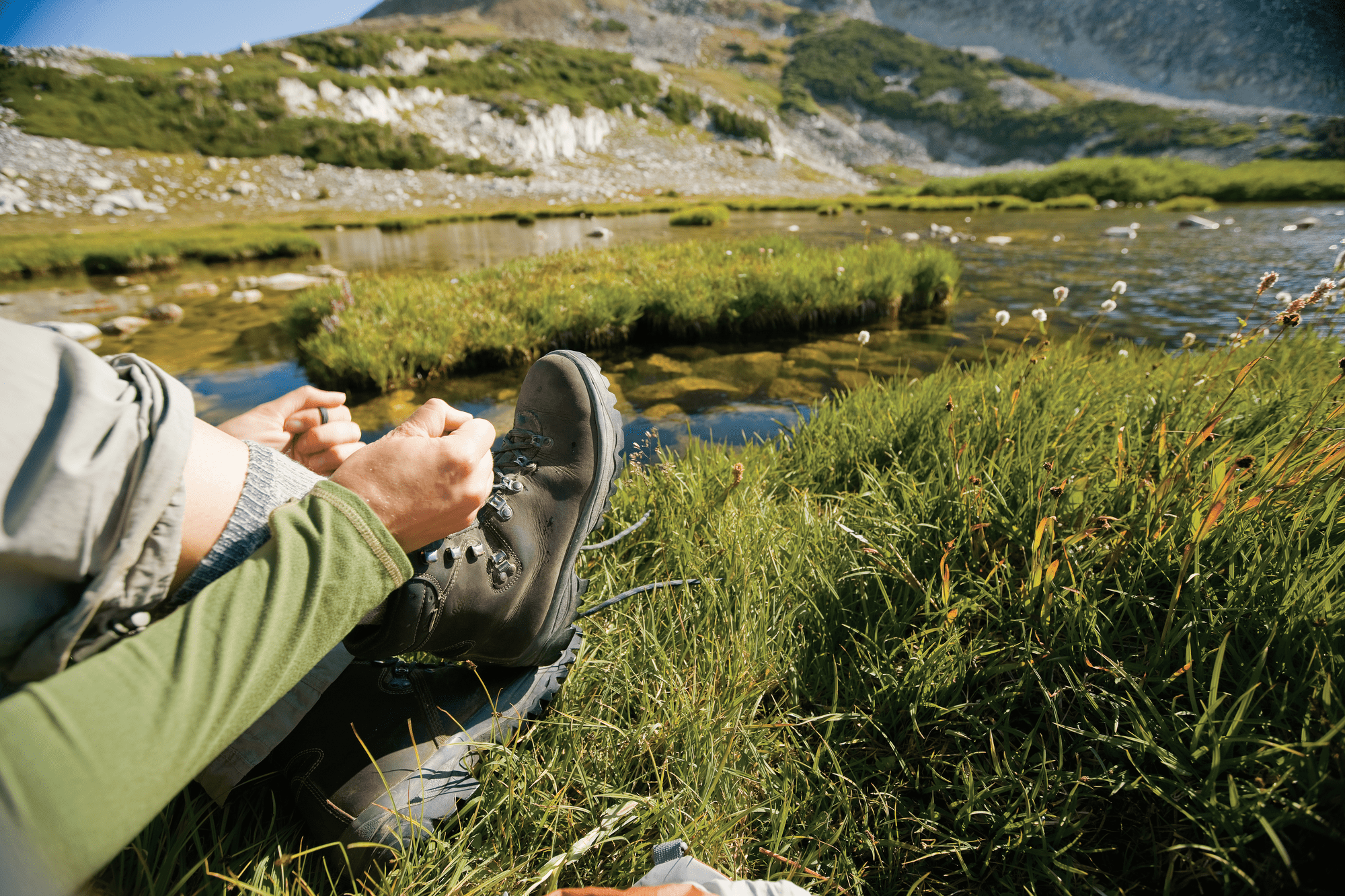 Angler Lacing Up Hiking Boots