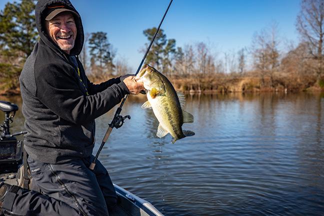 Pro Angler Lands Largemouth Bass