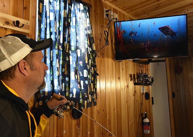 Angler Using Underwater Camera