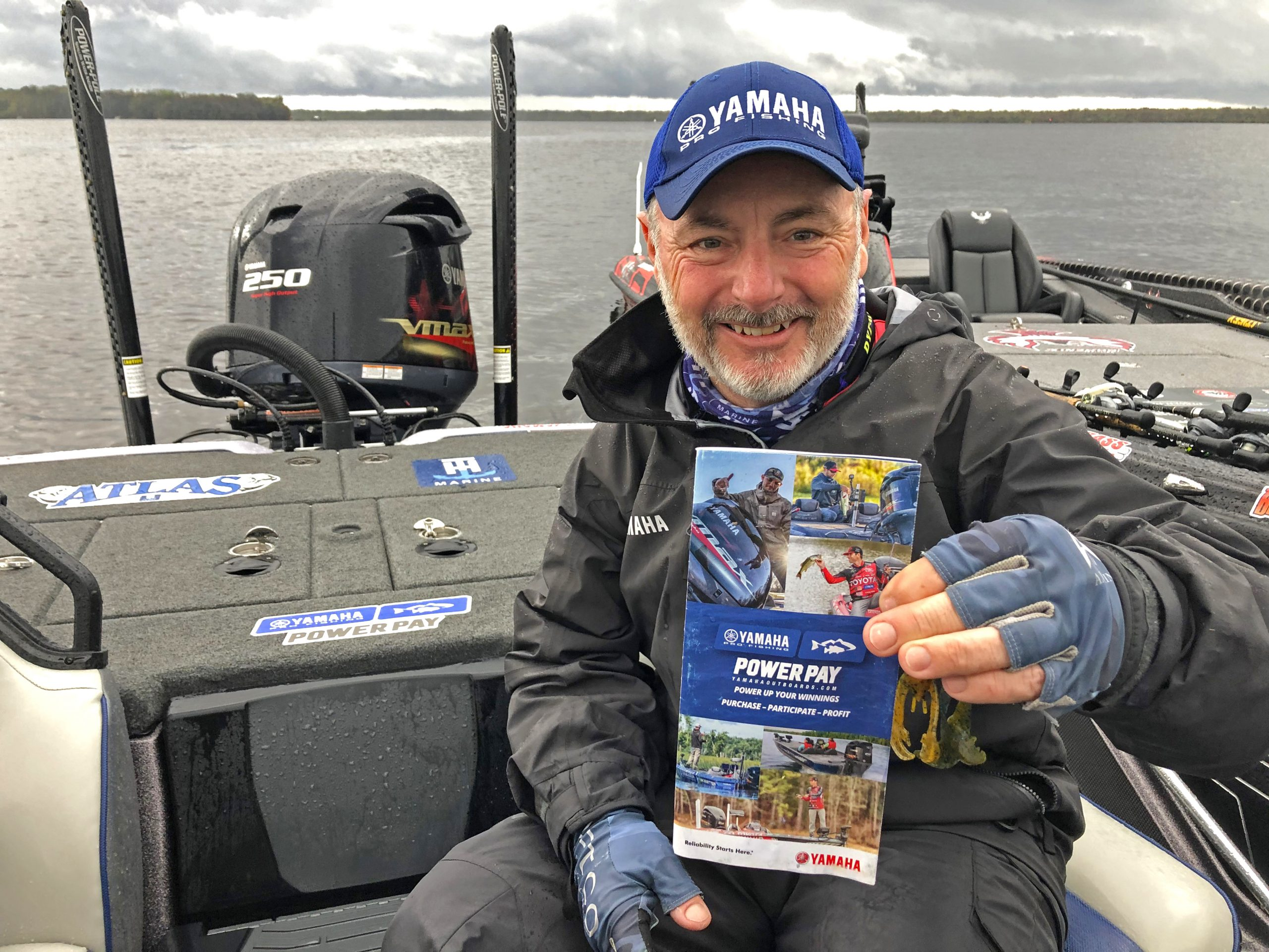 Angler holds up Power Pay brochure
