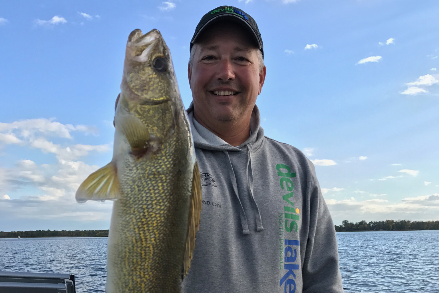 Angler on Devils Lake with Walleye
