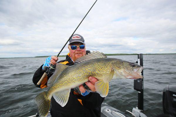 Angler holding walleye