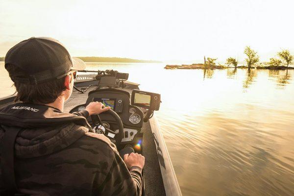 Angler Driving Boat using Marine Electronics