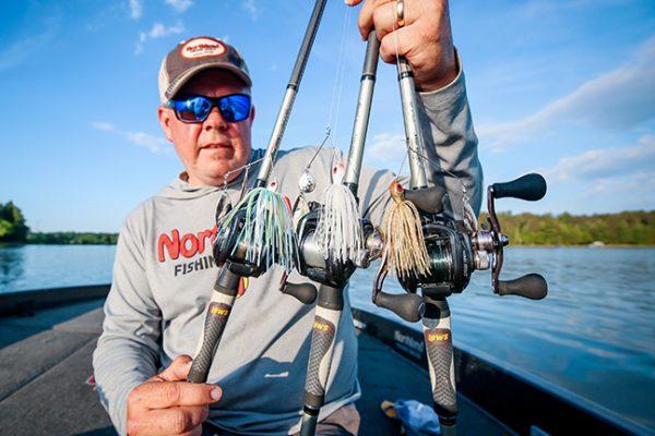 Angler holding fishing lures